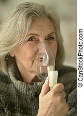 woman with flu inhalation - Portrait of elderly woman with...