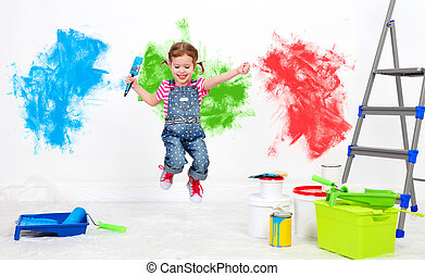happy funny child girl doing repairs, jumping and paint wall...