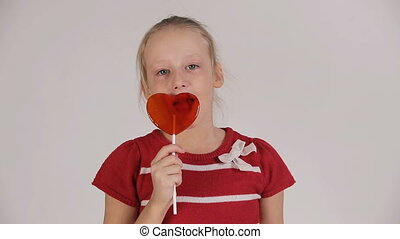 Child eating lollipop