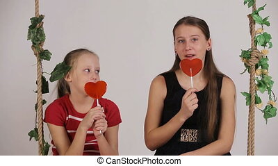 Kids eating lollipop