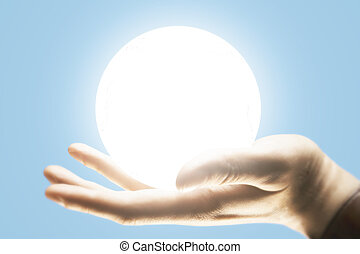 Hand holding illuminated ball - Sideview of male hand...