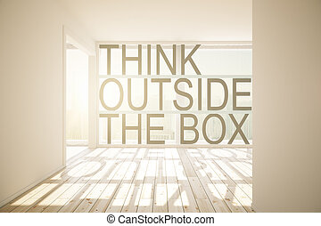 Thinking outside the box concept in concrete sunlit room...