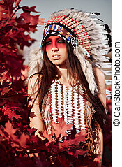 Beautiful girl in a suit of the American Indian on the...
