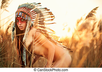 Beautiful girl in a suit of the American Indian