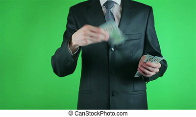 Handsome young man catching money on chroma key