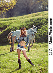 Horse and girl with cowboy hat - Young Cowgirl and Horse...