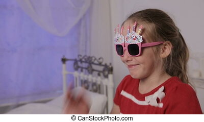Girl in glasses with the words happy birthday - Little girl...