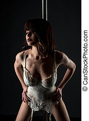 Image of sexy stripper in lace corset with garters - Studio...