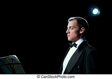 Image of music conductor focused before the show - Studio...