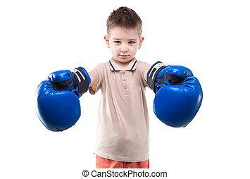 Smiling little boy with boxing gloves