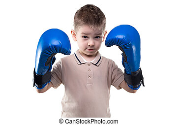 Cute serious little boy with boxing gloves