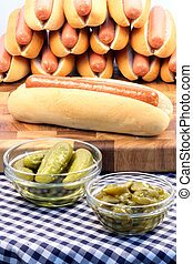 hot dogs - hot dog ingredients on a nice table setting rich...