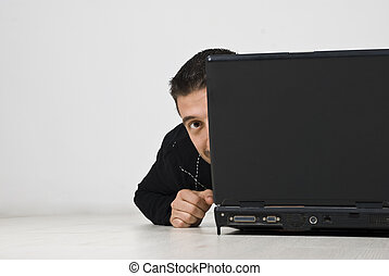 Man looking and hiding behind laptop - Man looking hiding...