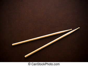 Couple of drum sticks on wooden desktop background