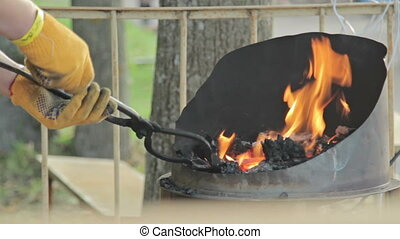 Blacksmith shapes hot steal - Working forge of the...