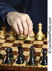 Hand moving pawn on chess board - Hand moving a pawn chess...