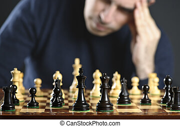 Man at chess board - Chessboard with man thinking about...