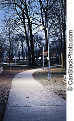 Park path at dusk - Path through city park at dusk with...