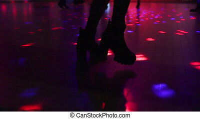 boots dancing in discotheque - woman in boots dancing on...