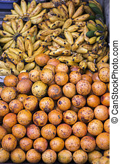 Oranges and banana, indonesian market stall - Oranges and...
