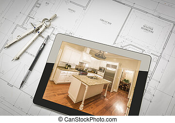 Computer Tablet Showing Finished Kitchen On House Plans,...