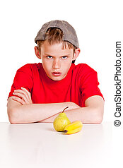Defiant young boy glowering at the camera - Defiant young...