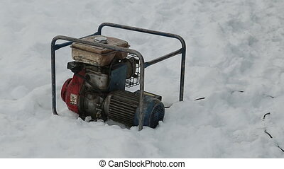 Old compressor on the snow