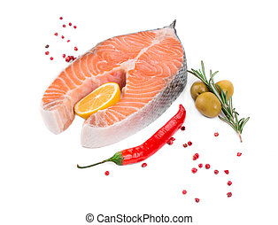 salmon fillet with lemon. Isolated on a white background.