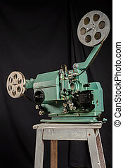 Worm's eye view of a retro movie projector on a black...