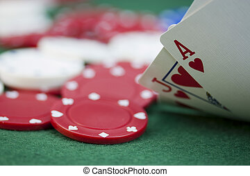 Poker chips and cards on a green table