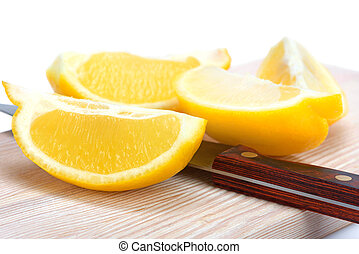 sliced lemon and knife - lemon cut into quarters and a knife...