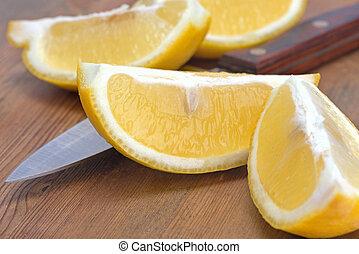 sliced lemon and knife