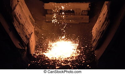 Drops of molten iron - Stages of the steel plant for the...