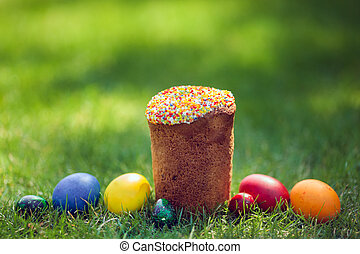 Fresh Easter cake with colorful decorative eggs - Easter...