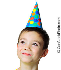 Happy birthday party - Portrait of eight years boy with...
