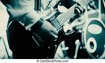 playing the guitar at the club under color music -...