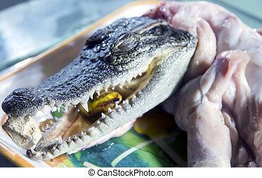 Asian fish market selling crocodile - At the Asian fish...