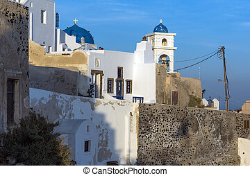 town of Imerovigli, Santorini - White house and churches in...