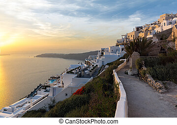 sunset view of town of Imerovigli - Panoramic sunset view of...