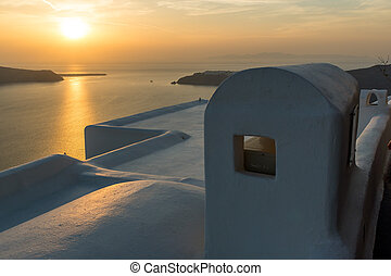 sunset view of town of Imerovigli - White roof and Amazing...