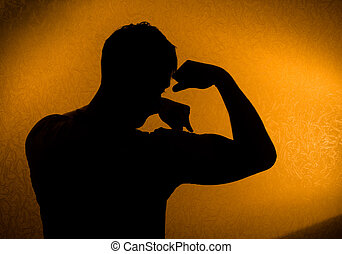 Strength and health. Silhouette of man in the darkness