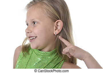 cute little girl pointing her ear in body parts learning...