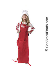 little girl in oversized cooking hat and red apron playing...