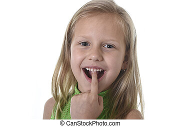 cute little girl pointing her teeth in body parts learning...