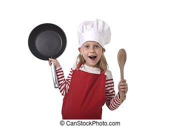 6 or 7 years old little girl in cooking hat and red apron...