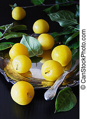 Ripe yellow plums - Organic ripe yellow plums in vintage...
