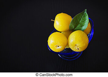 Ripe yellow plums - Organic ripe yellows plums in a glass...