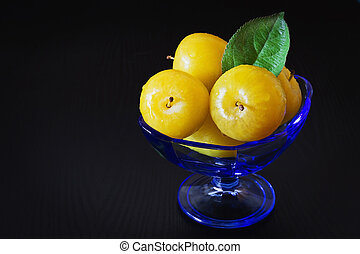 Ripe yellow plums - Organic ripe yellow plums in a glass...