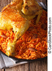 Traditional Arabic food: kabsa with chicken closeup. vertical