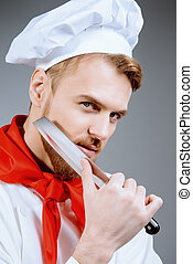 knife sharpening - Portrait of a professional male cook...